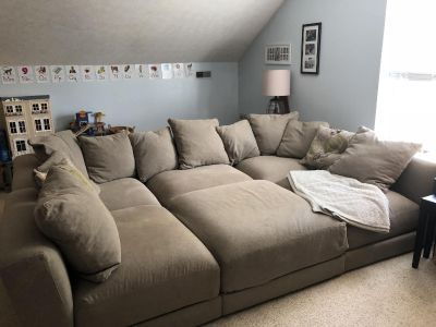 Massive sectional! 7 pieces (incl round ottoman see add. Photos) can be arranged so many ways!Cushions 12 thick! From macys paid 3000$
