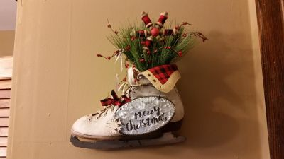 Antique ice skate decorated with black & red checks