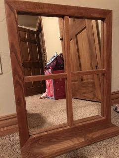 Wood trimmed mirror with shelf