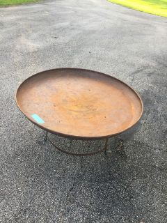 Outdoor coffee table. Rusty metal. 44 1.2 round Will be at my garage sale tomorrow 105 Schrader Lane, LJ