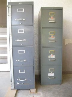 Two 4-drawer metal file cabinets