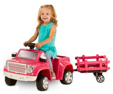 Girls ride on truck with trailer.