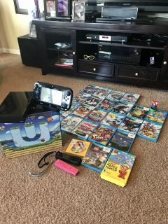 Wii U, game pod, 2 nunchucks, 24 games ( games alone are worth over $600) and a Mario pixel pal figure