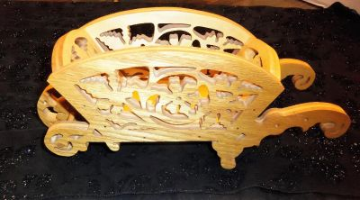 intricately carved wood wheel barrow*
