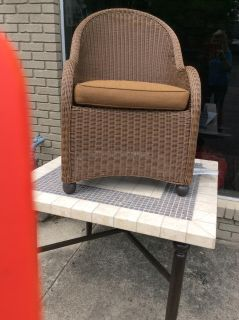 "40"" square tile table with 4 wicker chairs."