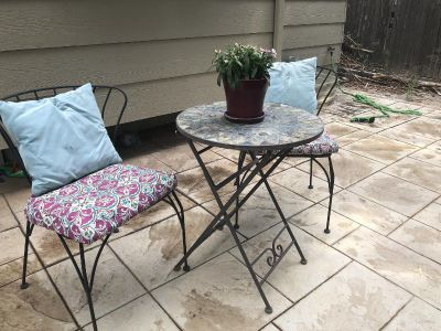Bistro table with chairs and cushions