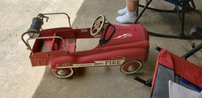 Firetruck pedal car with hose