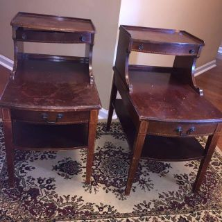 2 vintage Mersman 2 tiered wood side tables with 2 drawers and original hardware. Great project piece. See below for flaws