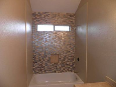 PROFESSIONAL TILE SERVICES STANDARD TUBS $650.00 (ANYWHERE)