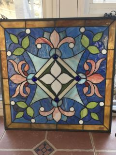 One of a kind, beautiful 19.75 x 19.75 square stained glass with sturdy metal chain to hang.