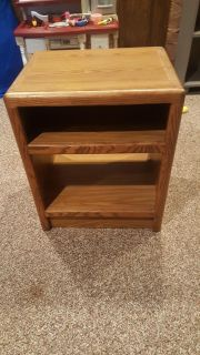 Wood night stand/with 2 shelves.