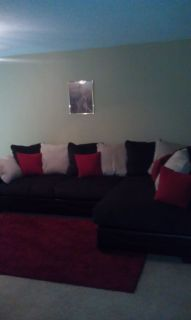 Brown sectional with pillows