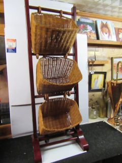 """41 1/2 x 15 1/2 x 11 3/4 deep solid wood rack and 3 wicker baskets are 11 1/2 x 7 x 8"""" deep"""