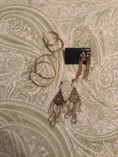 4 pairs of gold tone earrings. One new. Euc