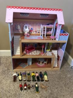 Dollhouse with furniture and dolls, play condition
