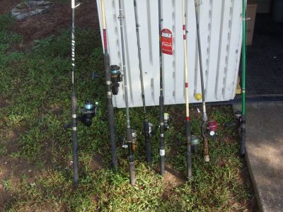 8 fishing poles and reels