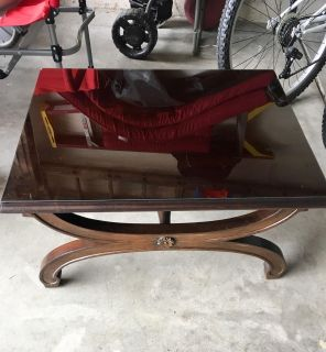 Dark brown colored coffee table