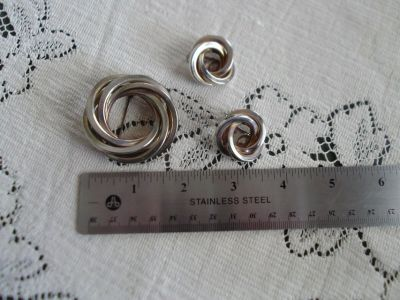 Gold and silver toned brooch and matching clip earrings