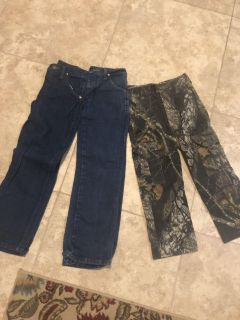 Lot of boys size 8 wranglers and camo pants-$15; Pearland porch pickup