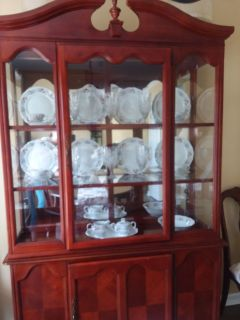 Beautiful dining room set... includes china cabinet, with dual sections.
