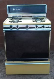 Kenmore harvest gold gas Stove.Pretty from the 70's