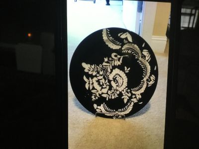 Black and white plate with stand