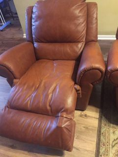Brown leather recliner and couch
