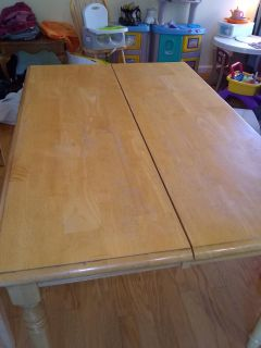 Dining table with built in leaf