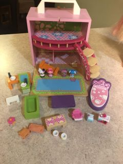 Wooden doll house with furniture and some Lala Loopsey dolls