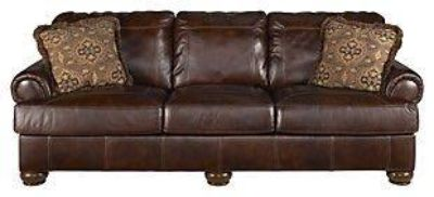 Brown Leather Sofa, Oversized Chair and Ottoman.