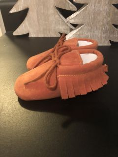 Never worn size 6/12 month moccs