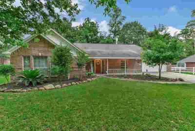 7014 Wedgewood Drive MAGNOLIA Three BR, This home shows great and