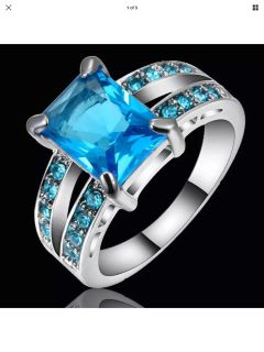 Silver layered cubic zirconia blue ring size 7 new and sealed.