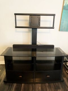 Beautiful and big tv stand with drawers and glass top