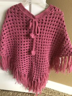 Girls hand crotchet poncho. Fits size 8-14. Only wore a few times