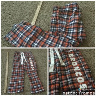 Women s size Medium NFL Broncos pajama pants, some light cosmetic wear from washing on the vinyl letters. $2.00
