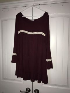 Burgundy tunic with cream colored lace flared sleeve.