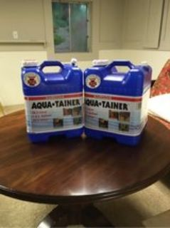 Two AquaTainer 7G Water Jugs