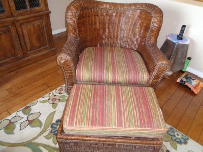 Two brown wicker chair with cushions