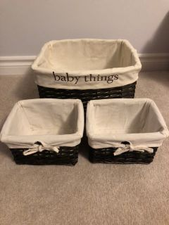 Set of 3 wicker baskets.