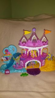 My little pony playset with 3 small and 3 med. Ponies. It also plays music, lights up and the baskets go around it. Also has a boat & comb.