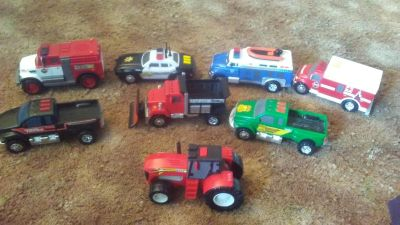 Trucks cars lot. Most make sounds and light up