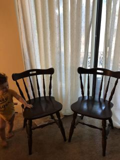 2 very well made brown wood chairs.