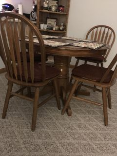 Solid wood table an 4 chairs with center leaf !