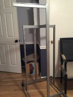 Commercial clothing rack, on wheels, 4 adjustable arms