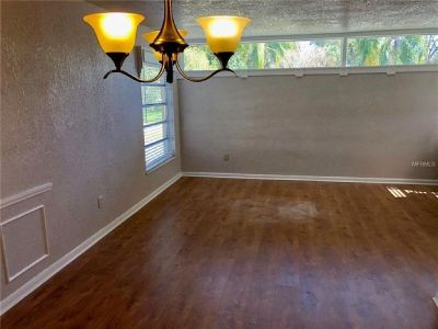 This home features newly painted exterior and interior, new kitchen with custom made wood cabinets.