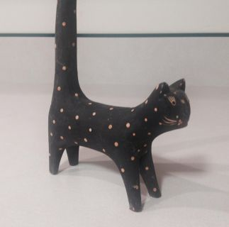 TWO PHOTOS WOODEN BLACK CAT WITH EXTRA TALL TAIL