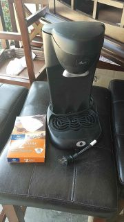 Coffee maker with a pack of cones