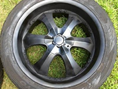 "$1,100 OBO set of 4 22"" rims and tires for 6 log GM pattern"