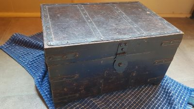 Antique wooden box with metal straps and studs